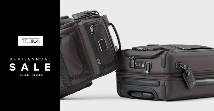 Copy: Tumi logo. Semi-annual sale. Select styles. Image: two Tumi suitcases shown