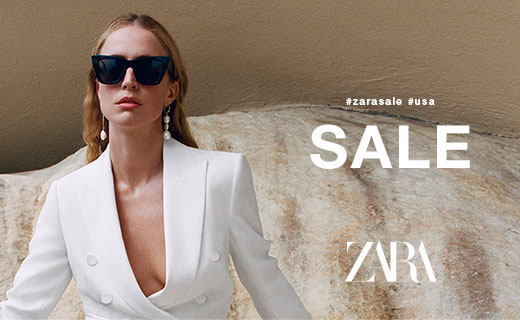 Copy: #zarasale #usa. Sale. Zara. Woman wearing white blazer, long earrings, dark sunglasses.