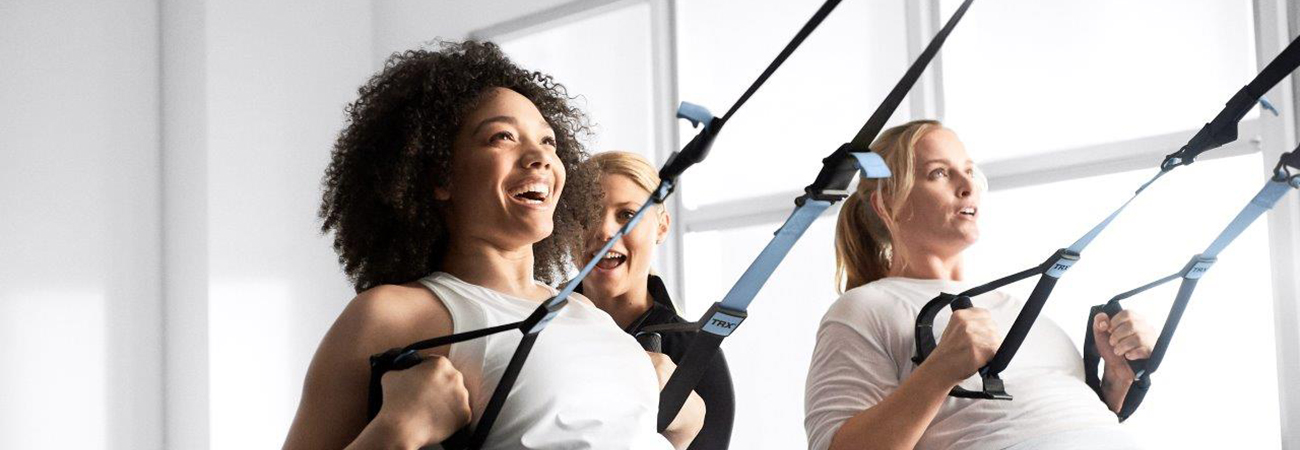 Women working out on the equipment at Life Time