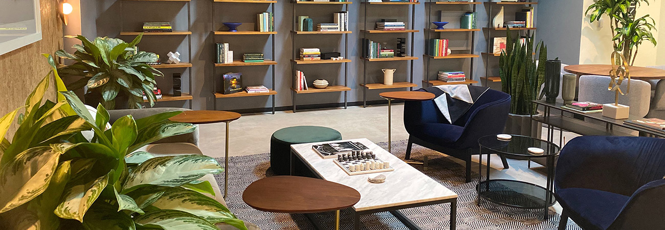 Chairs, tables, and bookshelves at Industrious
