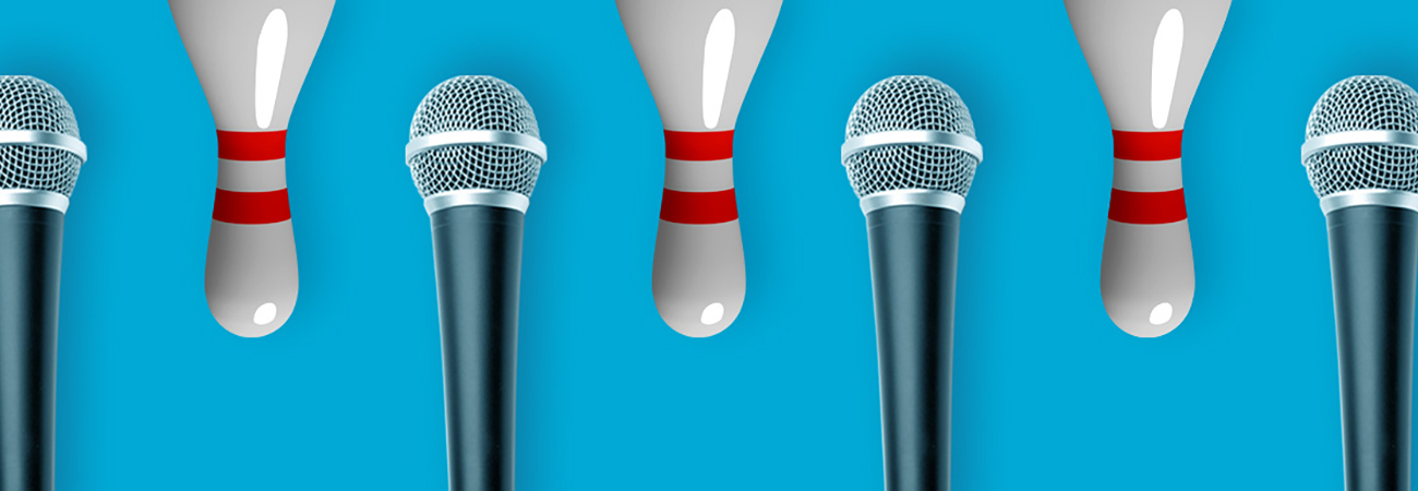 Microphones and upside-down bowling pins on a blue background