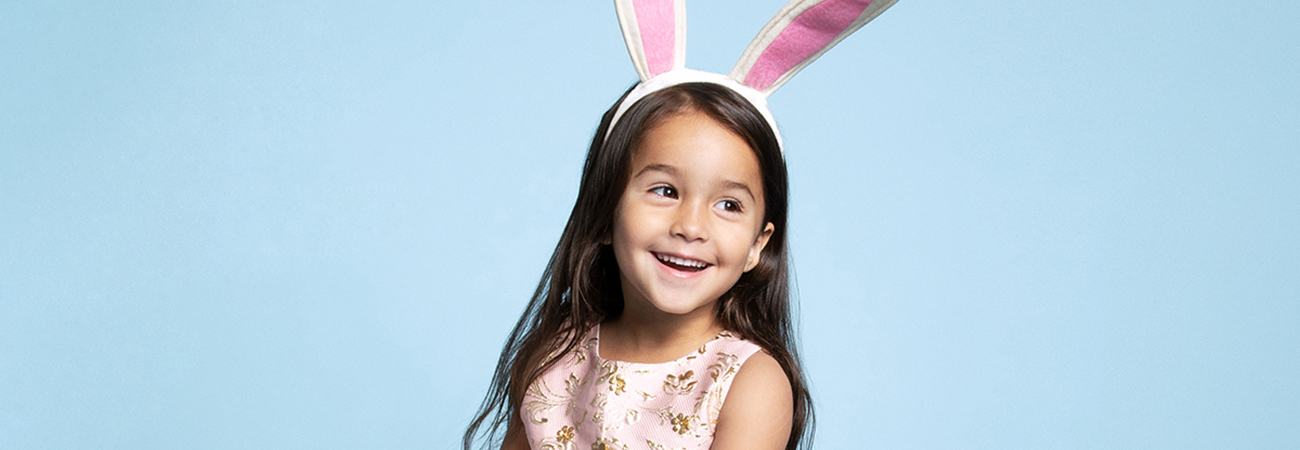 Smiling young girl wearing a bunny ears headband
