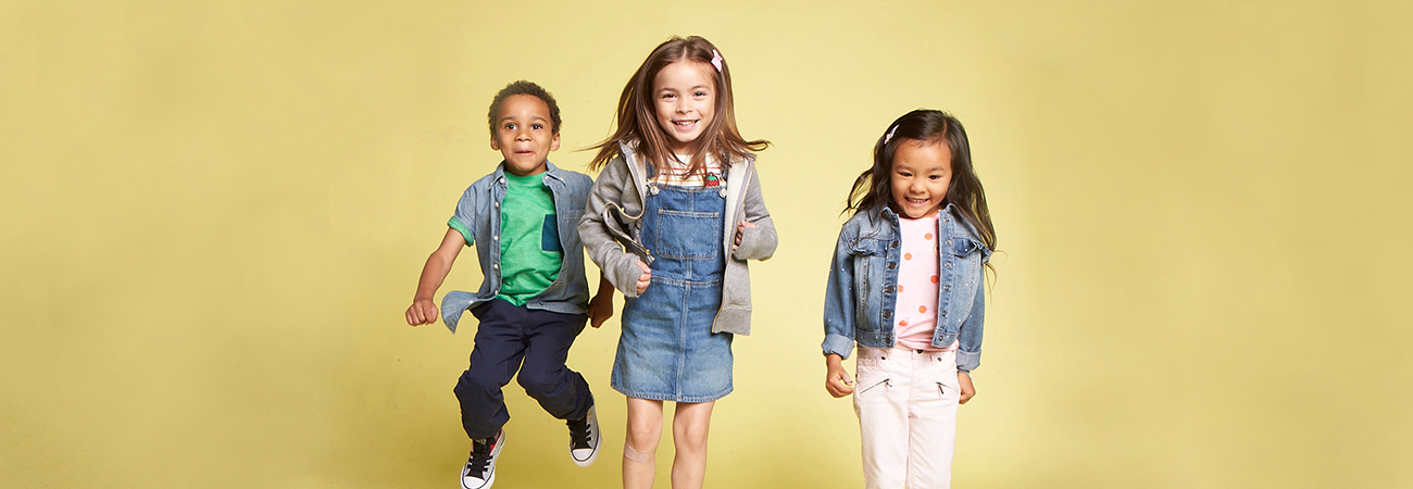 Three young kids jumping up