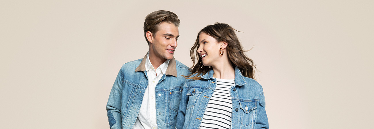 A young man and woman wearing denim jackets