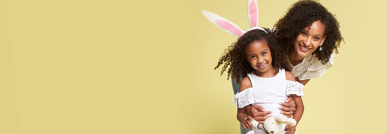Mommy and daughter, who is wearing Easter bunny ears headband
