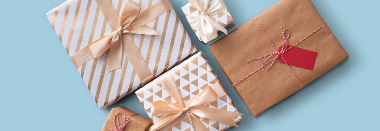 Presents in white and tan wrapping paper and bows