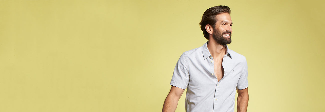 Man in a gray button-up short sleeve shirt