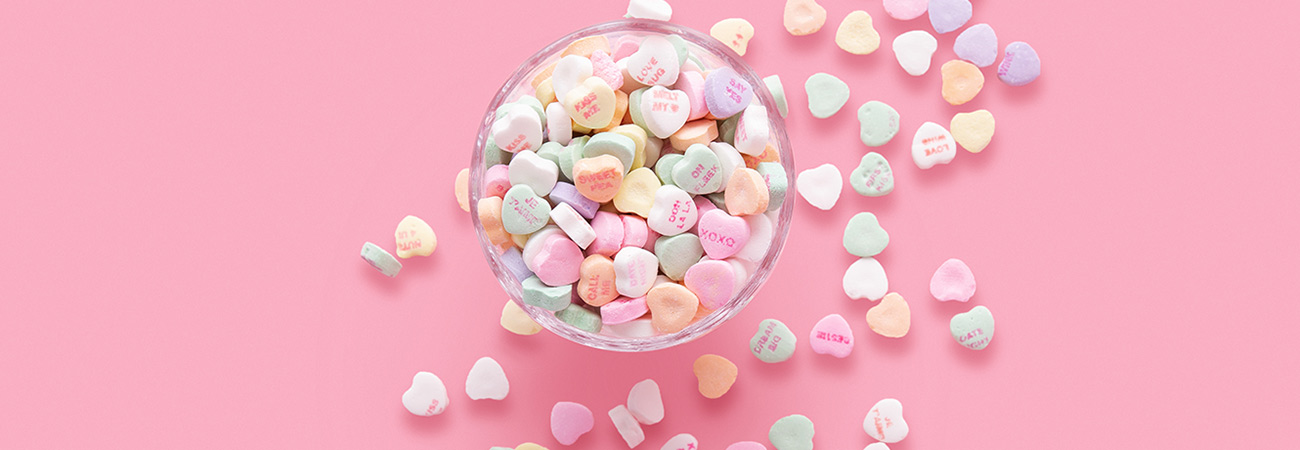 Valentine candy hearts on a pink background