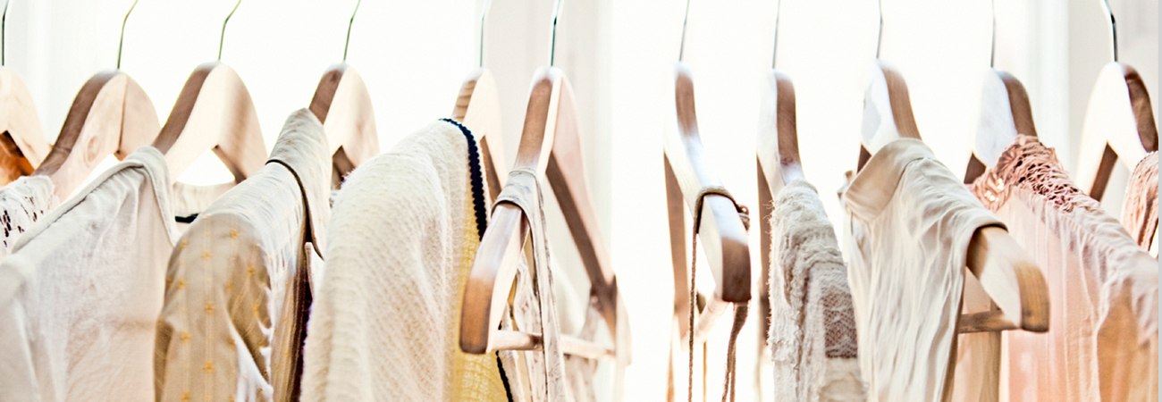 Women's summer clothing on wooden hangers