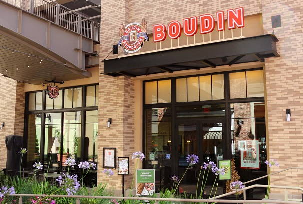 Storefront photo of Boudin at Broadway Plaza showing front patio and entrance doors.