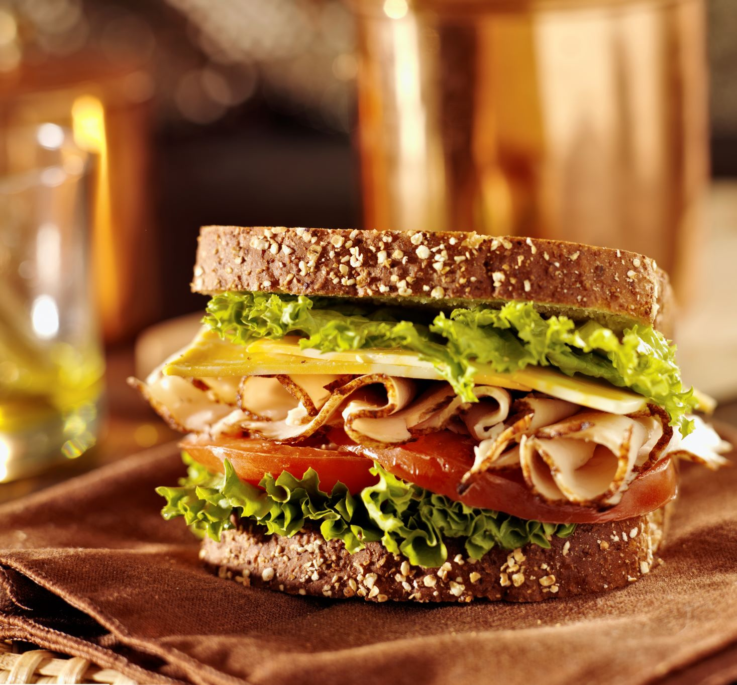 Turkey , cheese lettuce and tomato sandwich