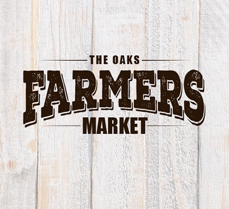 Farmers Market logo on wood plank background