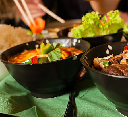 Bowls of Thai food on a table