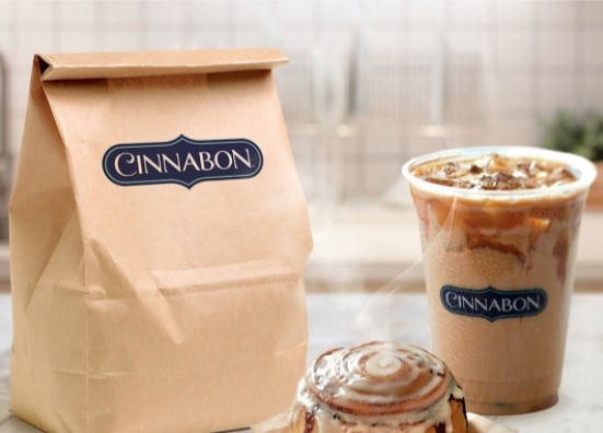 brown paper bag and iced coffee cup with cinnabon logo and small cinnabon