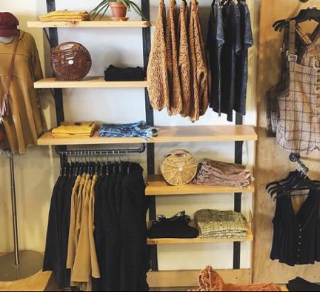 Clothing hanging on racks and shelves