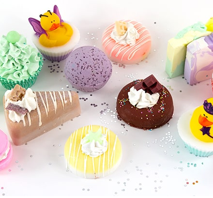Various soaps made to look like bakery items such as cake, cupcakes and donuts.