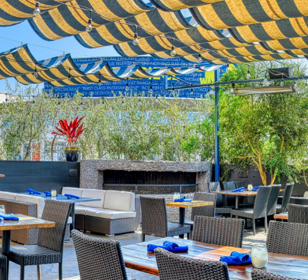 Rooftop dining room with yellow and blue accents