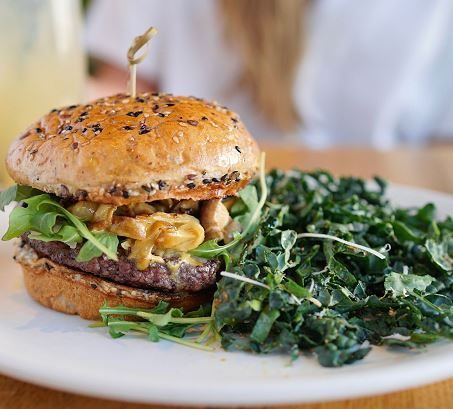 burger and side kale ceasar salad