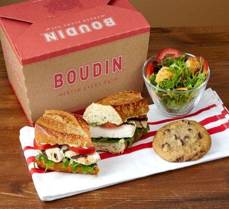 Image of Boudin to go box, sandwich, salad and cookie