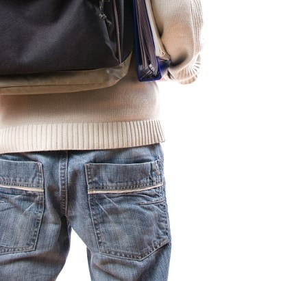 male student with jeans and backpack