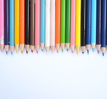 A row of colored pencils in different colors