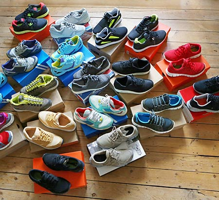 A collection of sneakers atop their boxes