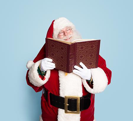 Santa holding a book