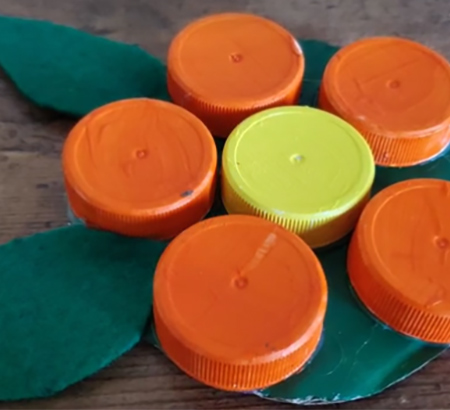 Example of the bottle cap coaster craft project.