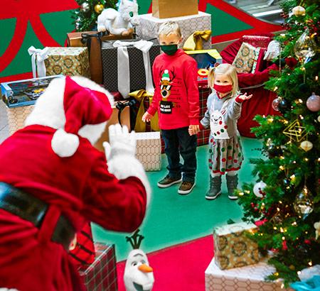 Kids visiting Santa to have their photo taken