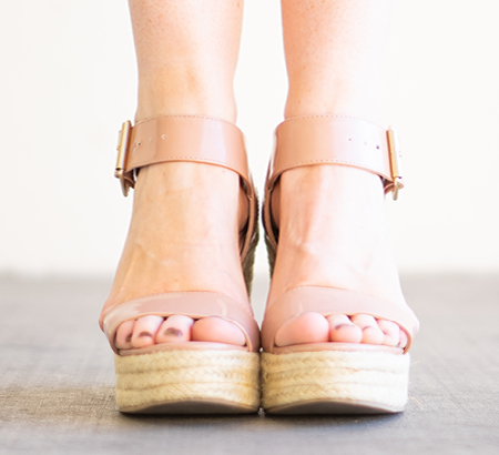 Close up of feet wearing a pair of women's platform espadrilles