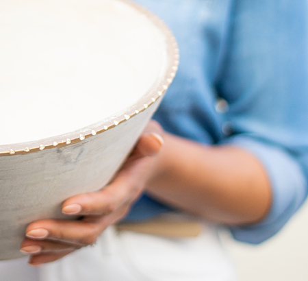 Woman holding a beach-inspired bowl