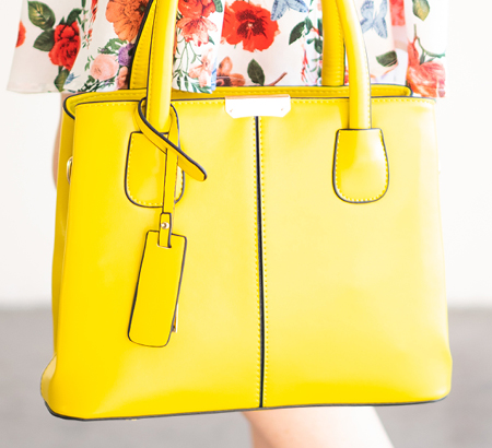 A bright yellow leather handbag