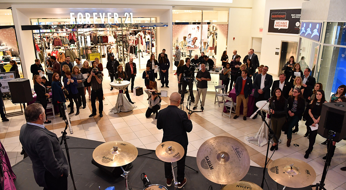 Band performing for a crowd at Fashion Outlets of Chicago