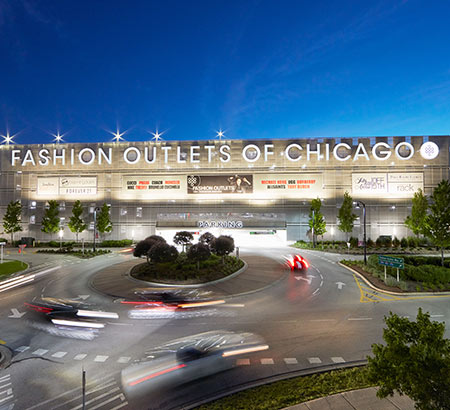Fashion Outlets of Chicago's exterior at night