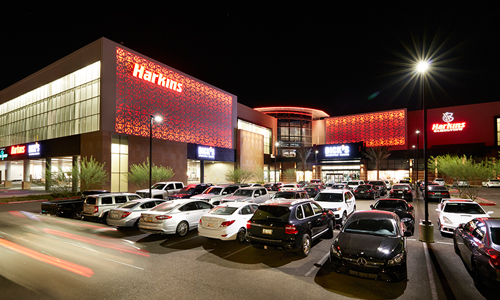 Harkins Theatres' exterior and parking lot at night