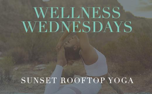 Wellness Wednesdays sunset rooftop yoga female doing a yoga pose in the desert