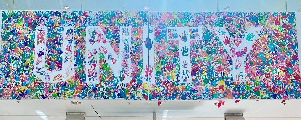 hand prints with word Unity