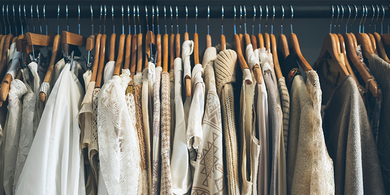 White and beige clothing on hangers