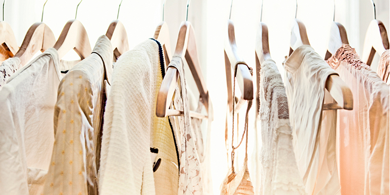 Light-colored clothes on hangers