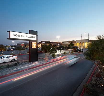 Image of South Plains Mall's exterior and sign at night