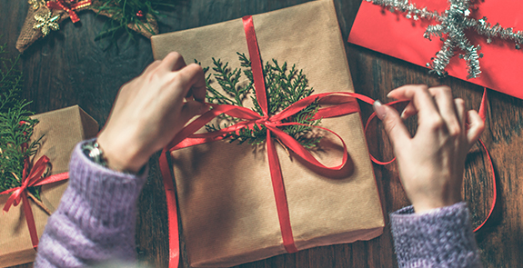 Brown paper gift with red ribbon