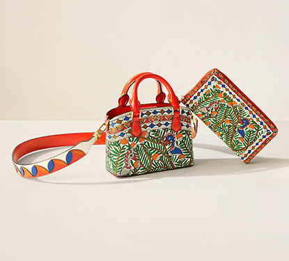 A Tory Burch purse with a tropical print design