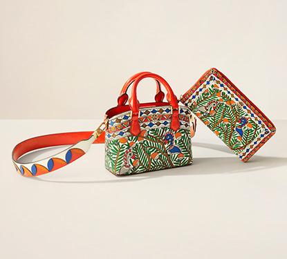 A Tory Burch purse with a tropical print design