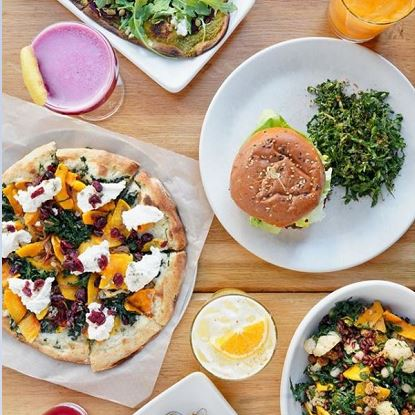assorted brunch of pizza, salad, burgers and smoothies