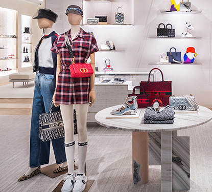 Luxury handbags, shoes, and fashions on display inside the new Dior store at Scottsdale Fashion Square