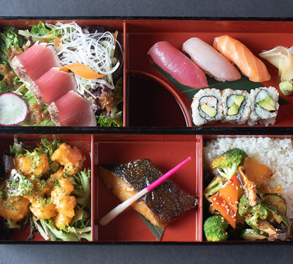 Sushi, sashimi, rice, vegetables with rice and wasabi