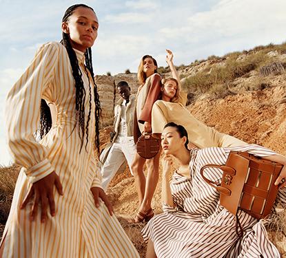 Five models posing in Salvatore Ferragamo