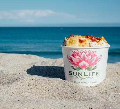 SunLife Organics acai bowl on the beach