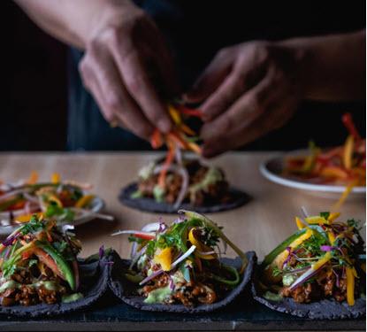 Chef making Toca Madera tacos
