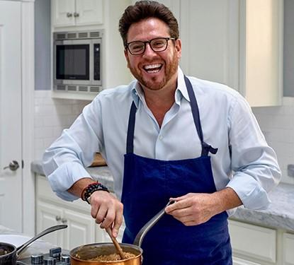 photo of scott conant in the kitchen